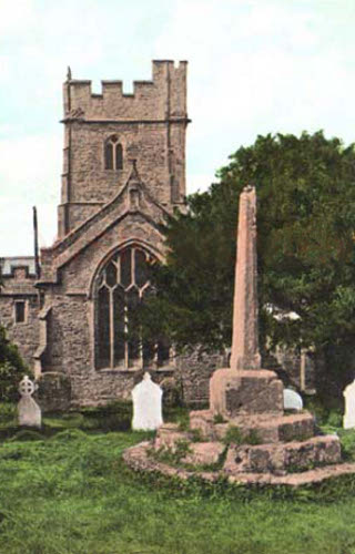 St George's, Bicknoller, the decrepit stone cross at the back of the church has been repaired with a cross added to the top.