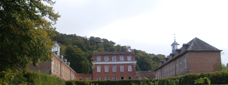 Crowcombe Court stable wings (now apartments) to the left and right, the main house at centre.