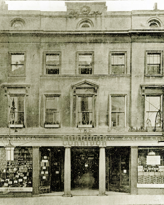 The Corridor shopping arcade, Bath, opened in 1834. This is the High Street entrance, photographed in the late 1800s..